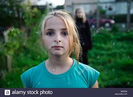 10 year old 10 year old girl staring at the camera looking wild and feral uk