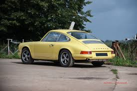 porsche yellow light yellow 911 road car in the tuthill porsche workshop
