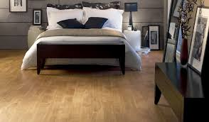 bedrooms with hardwood floors and area rugs white comfort bed plus