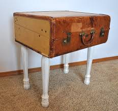old and vintage brown leather suitcase nightstand with white