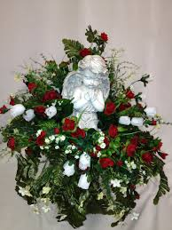 cemetery vase praying statue with roses white