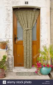 door with protection curtain to keep flies outside stock photo