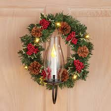 door wreath w candle sconce from collections etc