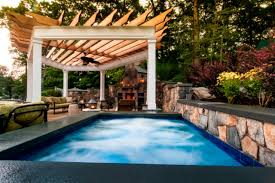Cool Pool Houses A New York Poolscape Accessorized With Stone And Rock Hgtv