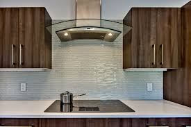 interior blue tile backsplash and brown wooden kitchen cabinet