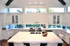 kitchen floating island white floating cabinets with window backsplash with dark cherry