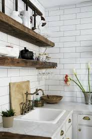 no cabinets in kitchen subway tile kitchen check out these wide wood beams as shelving