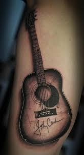 beautiful guitar tattoo by johnny cash