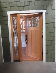 Metal Front Doors For Homes With Glass by Light Brown Wooden Single Door With Black Steel Handler Plus Glass