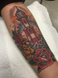 american traditional lighthouse by alvin aldridge at fine tattoo