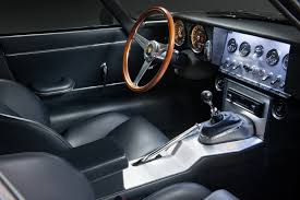 porsche race car interior would you rather porsche 911 by singer or eagle low drag gt