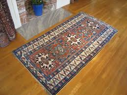 late 19th century varied red and blue lesghi star kuba rug for
