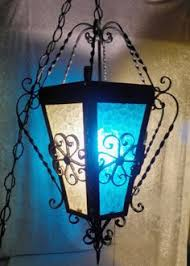 mexican wrought iron lighting matching pair of green mexico glass and wrought iron globes 95 00