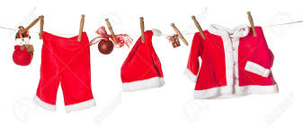 baby clothes for christmas and gifts hanging on a clothesline