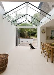 side infill dining room extension with a frameless glass roof and