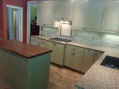 before and after refinishing these kitchen cabinets cabinet