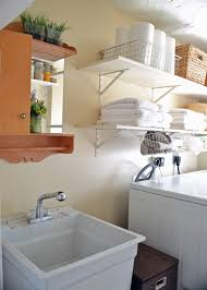 small laundry room ideas to try keribrownhomes furniture wall mounted towel rack and detergent storage organizing small laundry room design ideas