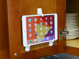 mount a tablet inside your kitchen cabinet for easy recipe reading