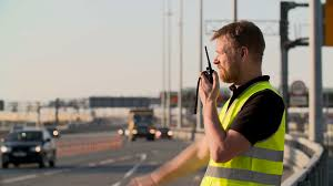 traffic police with walkie talkie work at highway stock video