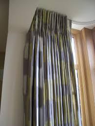 pinch pleat curtains using villa nova fabric on a silent gliss
