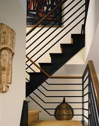 interior metal stair railing staircase contemporary with artwork