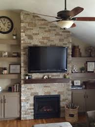 airstone fireplace with regency insert and floating shelves for