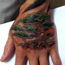 old bonsai tree male tattoo on hand with rising run