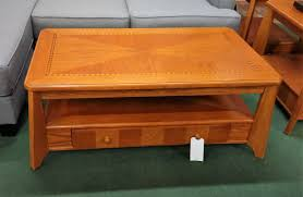 pre owned occasional tables lift top cocktail table light oak with two drawers 47x27x19h at normal position