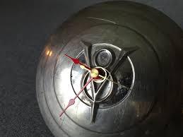 v8 hubcap clock u2013 1 of a kind object design