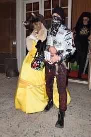 madonna wears freaky beast mask dresses belle