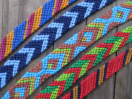 a colorful collection of hand made friendship bracelets
