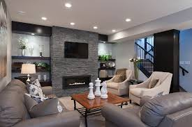 recessed lighting over fireplace basement fireplace basement transitional with tv mount over