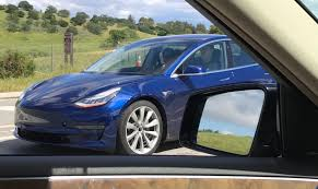 first sighting of a blue tesla model 3 testing on the freeway with