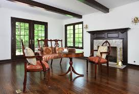 chicago red oak floors with traditional fireplace tools living room and exposed beams hearth
