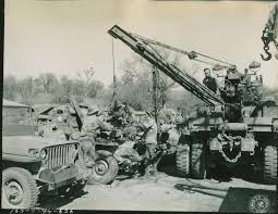 army jeep ww2 ten ton wrecker being used to remove motor from jeep at hunter