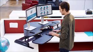 sit and stand desk converter varidesk cube corner 48 sit stand desk converter youtube