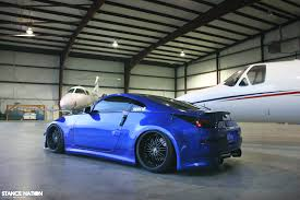 blue nissan 350z with black rims boosted beauty stancenation form u003e function