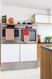 bold kitchen makeover orange highlights with retro danish styling