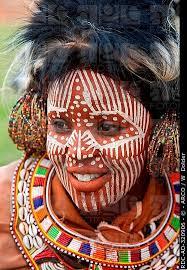 kikuyu with paintings and ornamental headdress