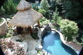 a terraced backyard frames this beautiful pool featuring boulder