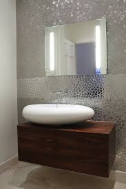 Bedroom Accent Wall With Snazzy Penny Tiles Decoist by 34 Best Bathroom Backsplash Images On Pinterest Backsplash