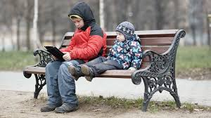 Wooden Park Bench Adorable Young Boy Watching His Brother As The Two Sit Together On
