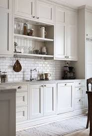 Floor To Ceiling Cabinets For Kitchen Interiors Butler Sink Wood Counter And Subway Tiles