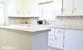 Granite Kitchen Makeovers - gorgeous budget kitchen makeover with white concrete countertops