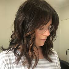 framed face hairstyles with bangs 28 popular medium length hairstyles with bangs updated for 2018