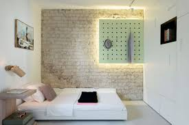 brick wall apartment small apartment refreshed with color and a new interior design