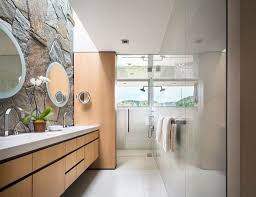 narrow contemporary bathroom with mounted vanity cabinets and