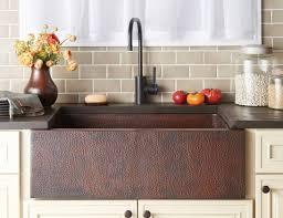 hammered copper kitchen sink with bronze faucet copper kitchen