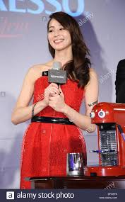 nespresso commercial female actress actress ning chang presents commercial activity held by coffee brand