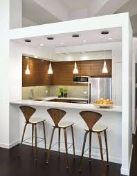 kitchen with modern bar table and modern stools also tiles white